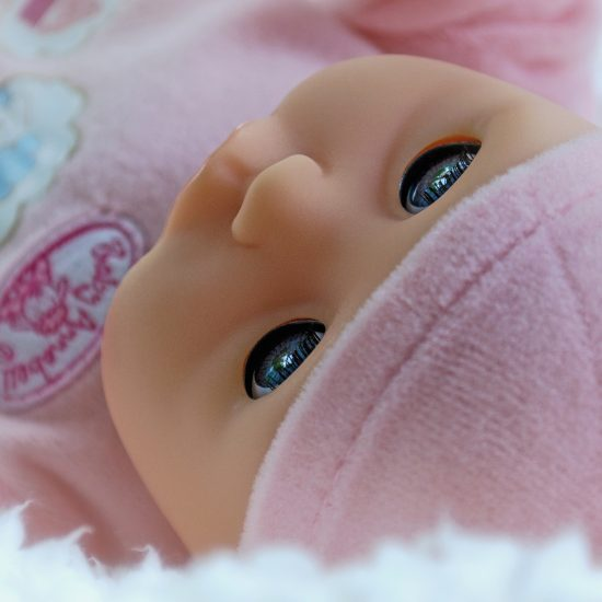 Baby doll dressed in pink