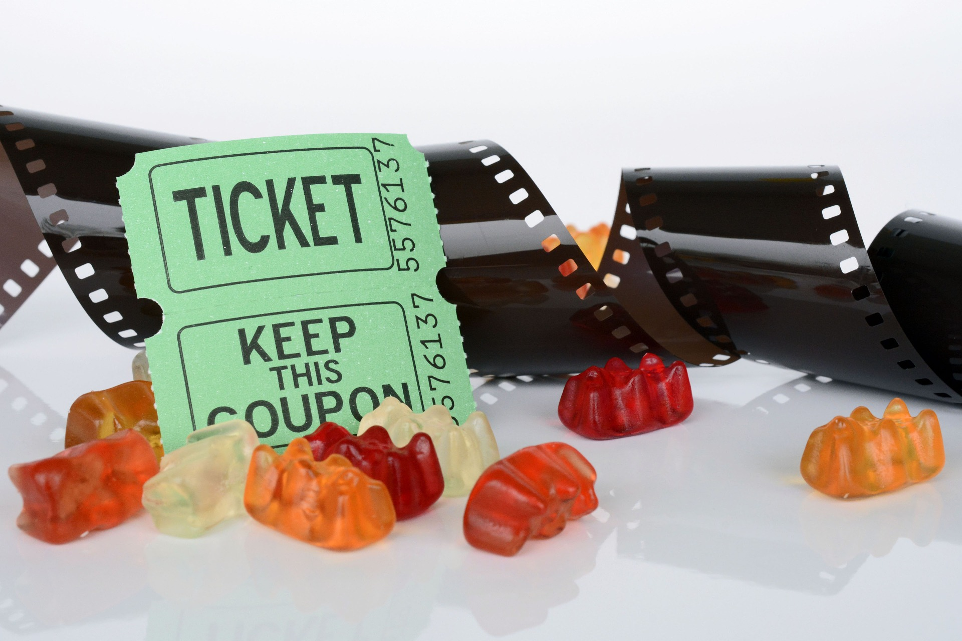 Film roll, ticket and gummy bears