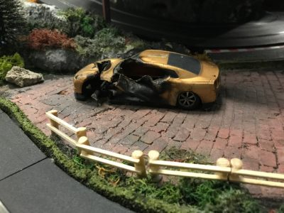 burnt out car on Scalextric track at Stonerig Raceway