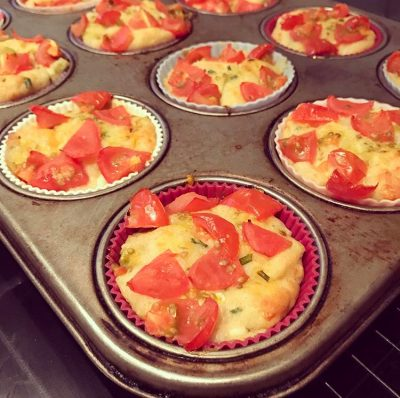 tomato and cheese muffins fresh out of the oven, still in baking tray