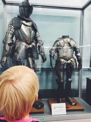 Tall Boy looking at a suit of armour, Salford Art Gallery