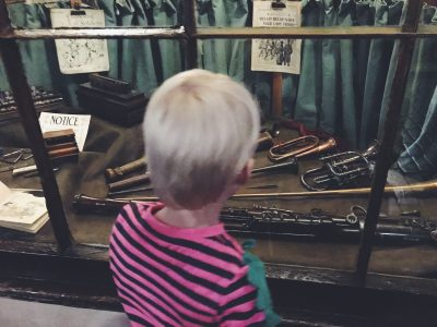 Tall Boy investigating the music shop at Salford Museum